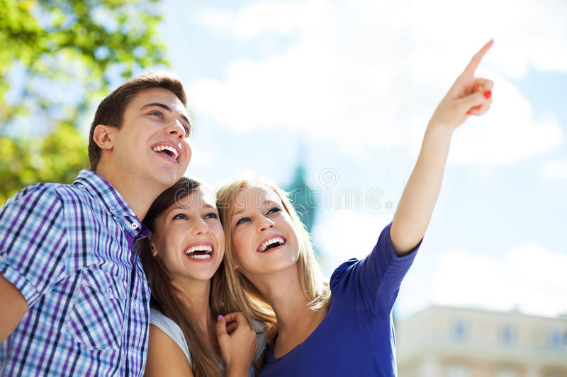Three Young Friends Pointing Stock Photos