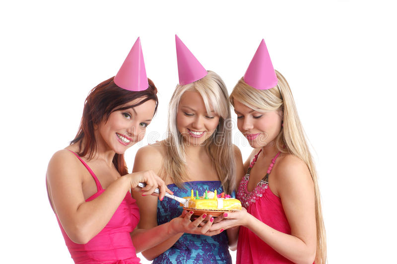 Three young girls celebrate a birthday party stock images