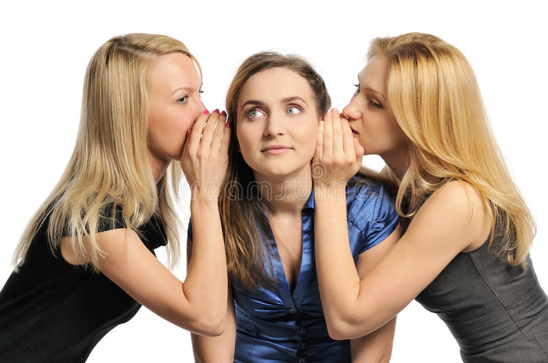 Three young girls gossiping royalty free stock images