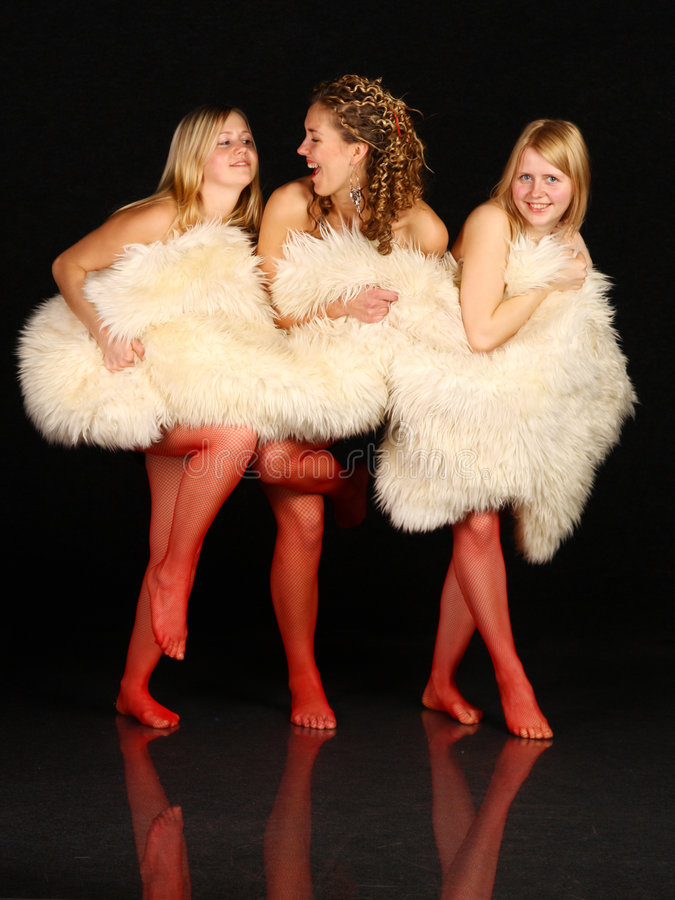 Download Three Young Girls Hiding Behind White Fur. Stock Photo - Image: 7790488