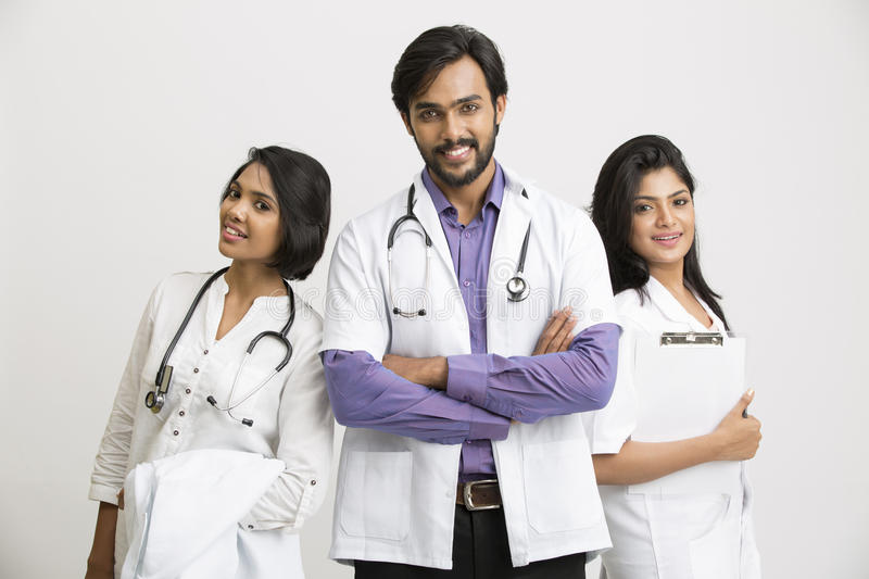 Three young Indian attractive doctors stock image