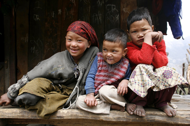 Three young kids on the annapurna circuit stock photo