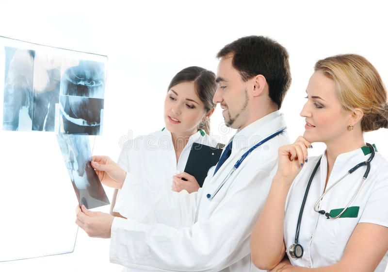 Download Three Young Medical Workers Examining X-rays Stock Photo - Image of doctor, attractive: 25998988