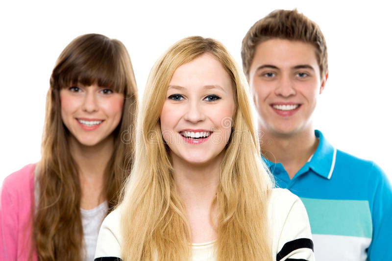 Three young people. Over white background royalty free stock images