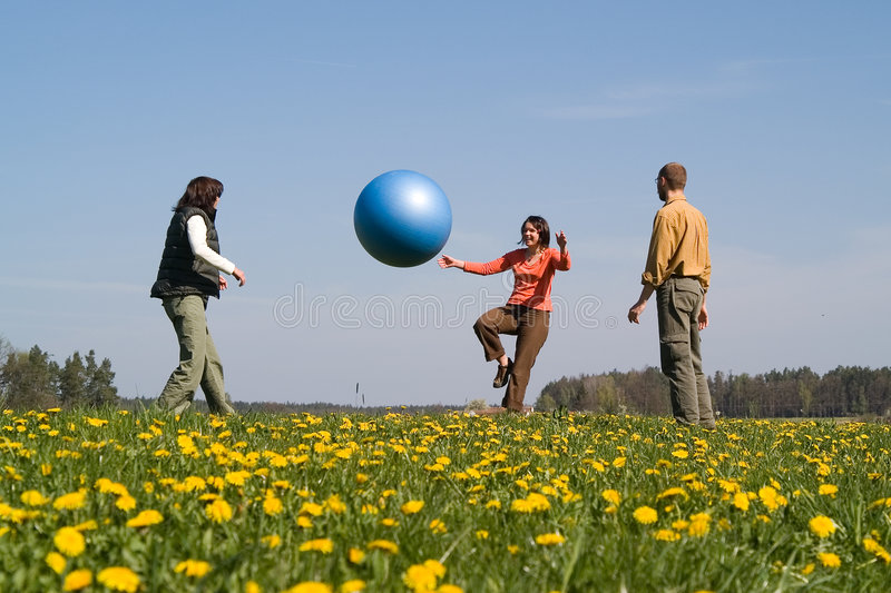 Download Three Young People With Ball Stock Photo - Image: 2420808