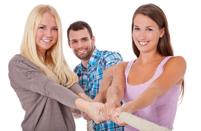 Three young people pulling rope stock photos