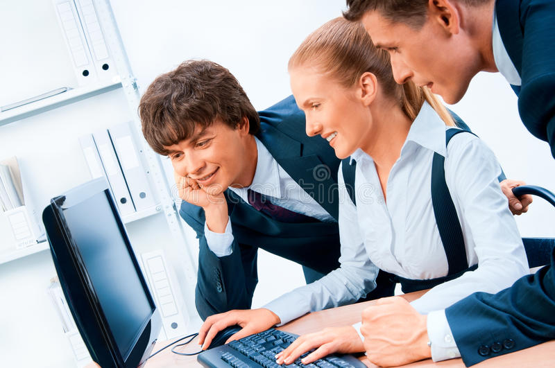 Three young successful businesspeople royalty free stock image