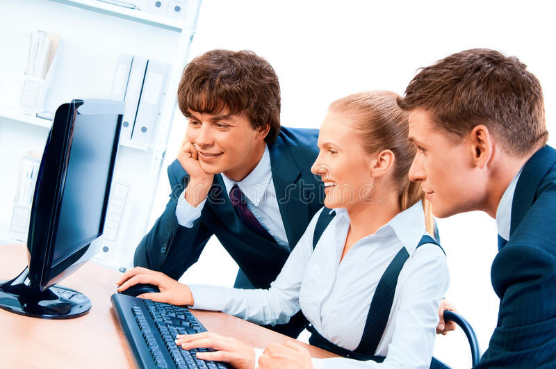 Three young successful businesspeople. royalty free stock images