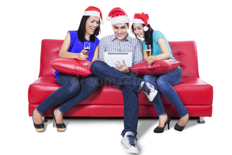 Download Three Young Teenager Drink Wine With A Tablet Stock Image - Image: 34554323