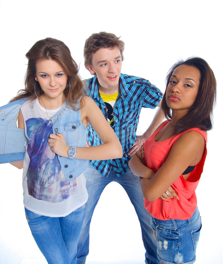 Three young teenagers. Portrait of three young teenagers grimacing. Isolated on white background stock images