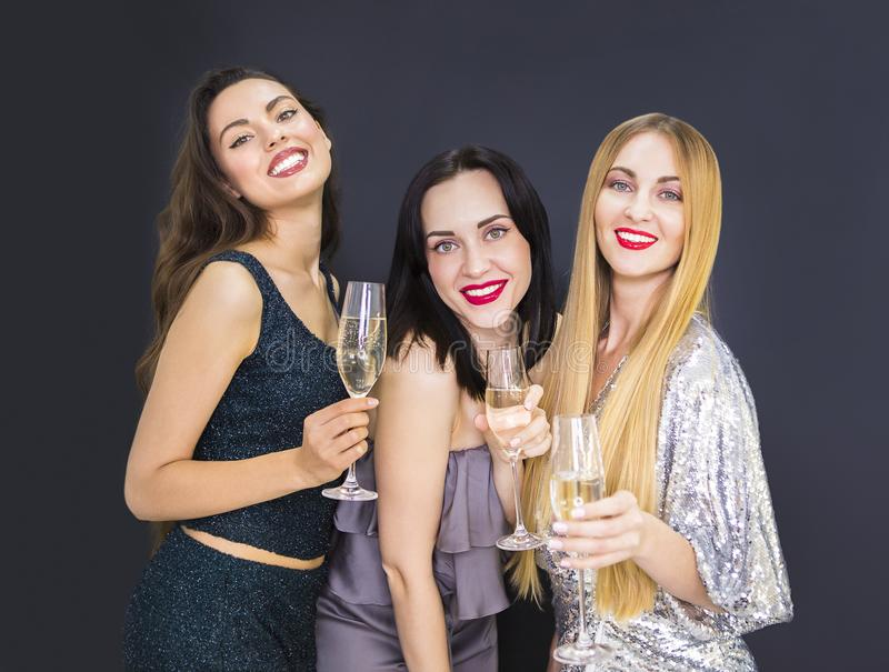 Three young woman having fun with champagne royalty free stock image