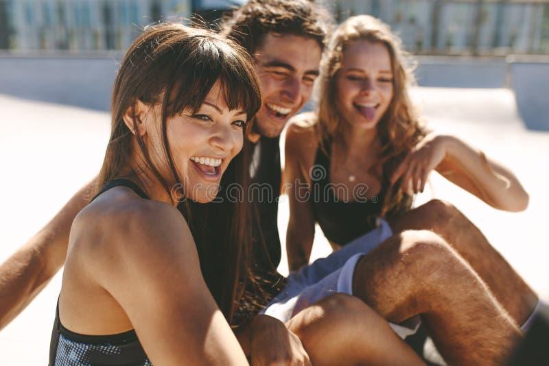 Cheerful friends taking selfie stock photo