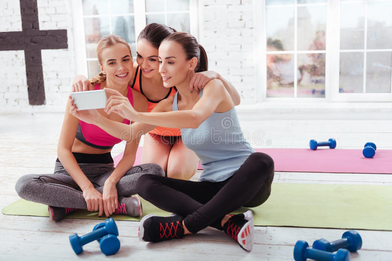 Three young women making selfie after workout royalty free stock images