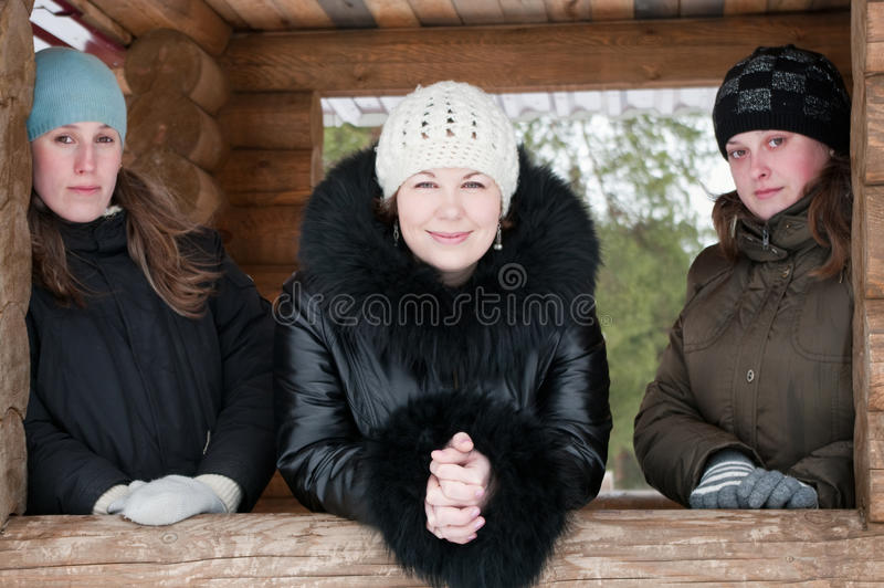 Three young women in winter clothes