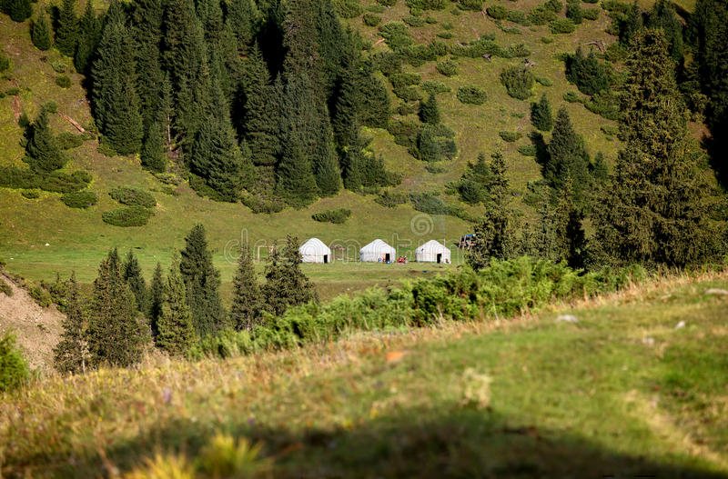 Three Yurt Nomad`s tent in mountains stock photo