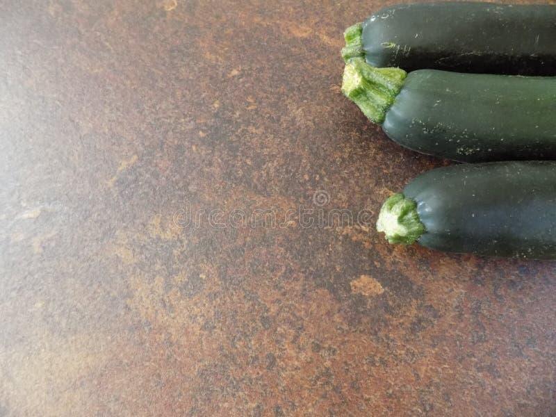 Three zucchinis stock images