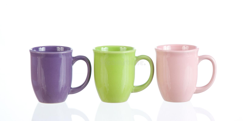 threesome的coffeecups 免版税库存图片