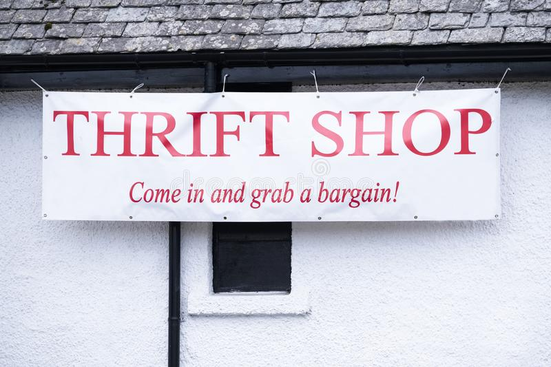 Thrift charity shop banner sign in poor rural town uk. Uk stock photography