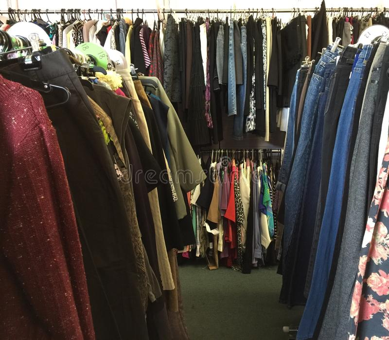 Thrift store. Clothing racks in a thrift store royalty free stock photos