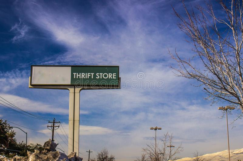 Thrift Store Sign In Winter. Thrift Store Parking Lot Sign In Winter royalty free stock image