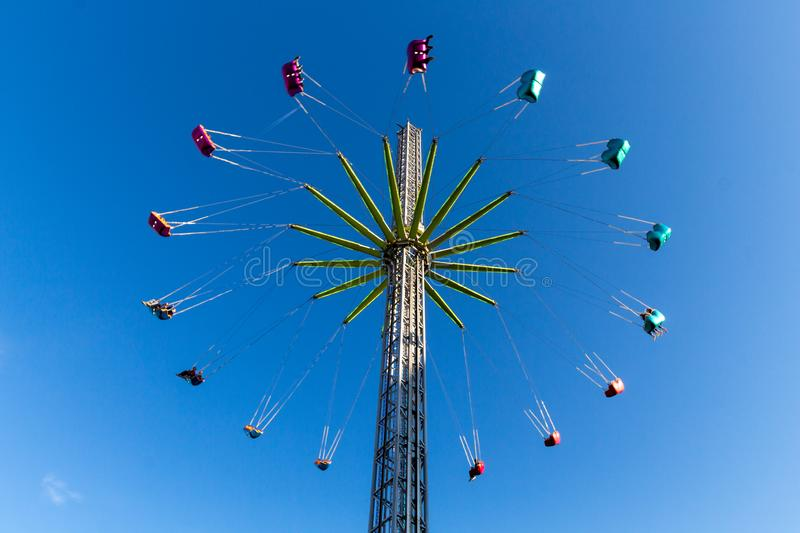 Thrill seeking attraction at the annual fun fair at the Vrijthof square in Maastricht. Reaching 65 meters height stock photos