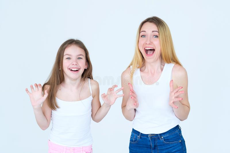 Thrilled emotional amazed mom kid joyful reaction. Thrilled emotional amazed mother and daughter. joyful reaction to happy news. mom and kid with happy smiles royalty free stock images