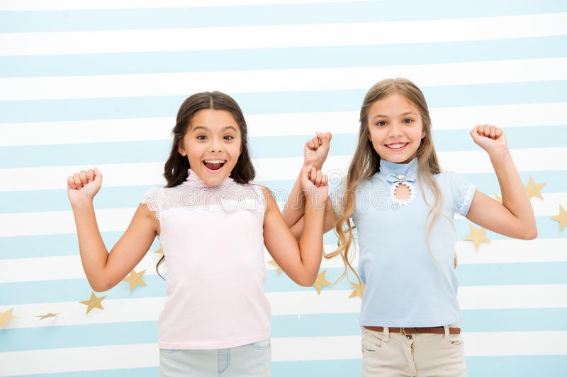 Thrilled moments together. Kids schoolgirls preteens happy together. Girls smiling happy faces excited expression stand royalty free stock image