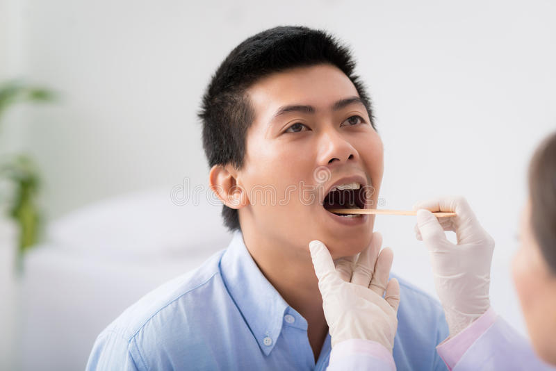 Throat examination royalty free stock images