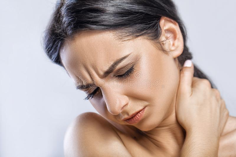 Throat Pain. Closeup Of Sick Woman With Sore Throat Feeling Bad, Suffering From Painful Swallowing. Beautiful Girl Touching Neck. With Hand. Illness, Health royalty free stock image