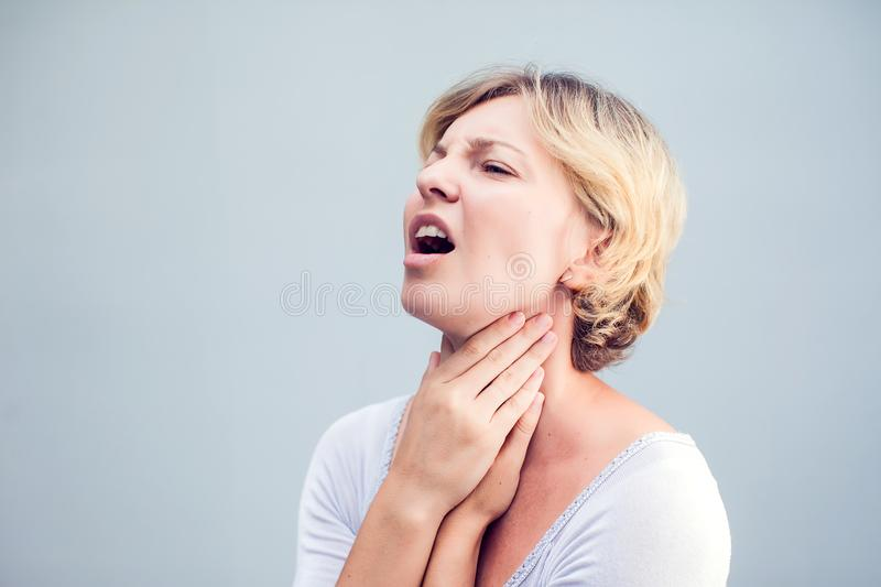 Throat Pain. Closeup Of Sick Woman With Sore Throat Feeling Bad, Suffering From Painful Swallowing. Beautiful Girl Touching Neck stock image
