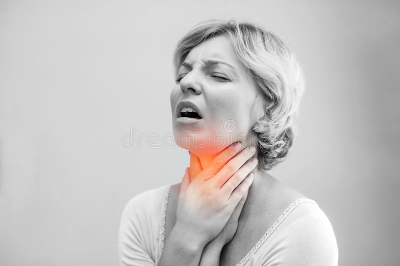 Throat Pain. Closeup Of Sick Woman With Sore Throat Feeling Bad, Suffering From Painful Swallowing. Beautiful Girl Touching Neck. With Hand. Illness, Health stock photography