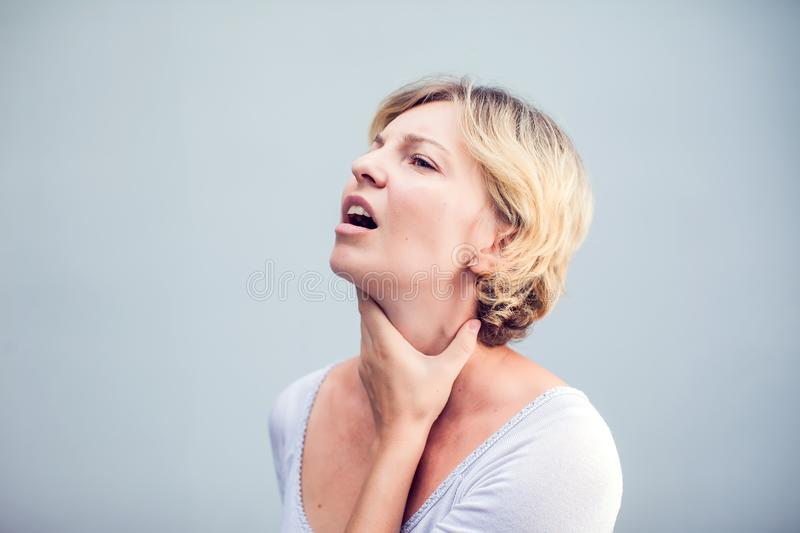 Throat Pain. Closeup Of Sick Woman With Sore Throat Feeling Bad, Suffering From Painful Swallowing. Beautiful Girl Touching Neck. With Hand. Illness, Health stock images