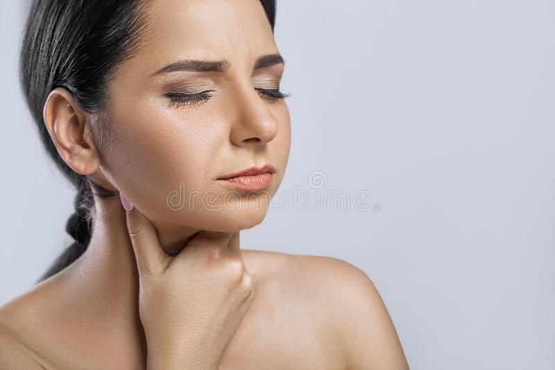 Throat Pain. Closeup Of Sick Woman With Sore Throat Feeling Bad, Suffering From Painful Swallowing. Beautiful Girl Touching Neck. With Hand. Illness, Health stock photos