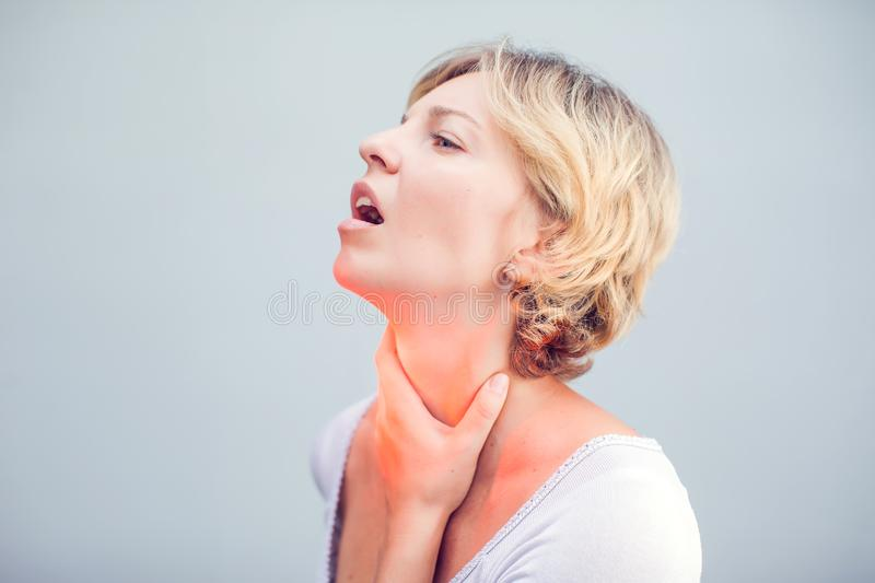 Throat Pain. Closeup Of Sick Woman With Sore Throat Feeling Bad, Suffering From Painful Swallowing. Beautiful Girl Touching Neck. With Hand. Illness, Health royalty free stock photography