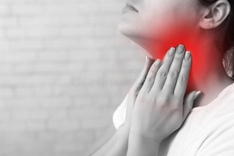 Throat pain. IIll woman with sore throat feeling bad royalty free stock images