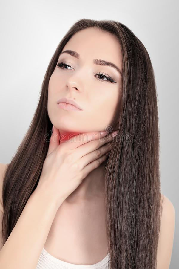 Throat Pain. Ill Woman With Sore Throat Feeling Bad, Suffering From Painful Swallowing, Strong Pain In Throat, Touching Neck With. Hand. Beautiful Woman Caught royalty free stock images