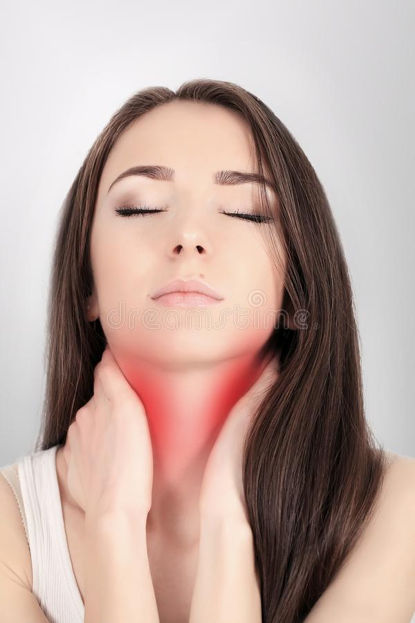 Throat Pain. Ill Woman With Sore Throat Feeling Bad, Suffering From Painful Swallowing, Strong Pain In Throat, Touching Neck With. Hand. Beautiful Woman Caught stock photography