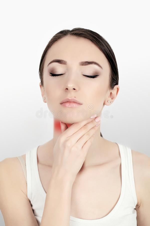 Throat Pain. Ill Woman With Sore Throat Feeling Bad, Suffering From Painful Swallowing, Strong Pain In Throat, Touching Neck With. Hand. Beautiful Woman Caught royalty free stock photo