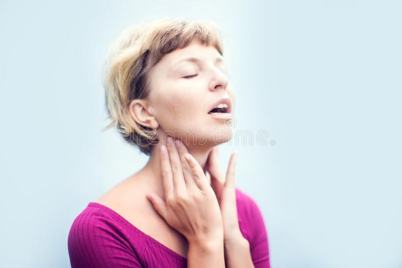 Throat Pain. Ill Woman Suffering From Painful Swallowing, Touching Neck With Hand. Female Caught Cold. Healthcare and medicine Co. Throat Pain. Ill Woman royalty free stock image