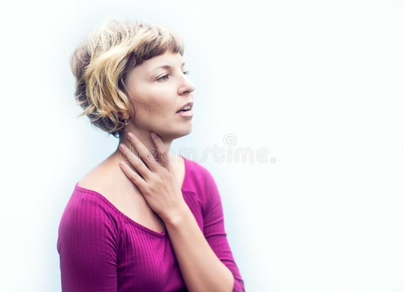 Throat Pain. Ill Woman Suffering From Painful Swallowing, Touching Neck With Hand. Female Caught Cold. Healthcare and medicine Co. Throat Pain. Ill Woman royalty free stock images