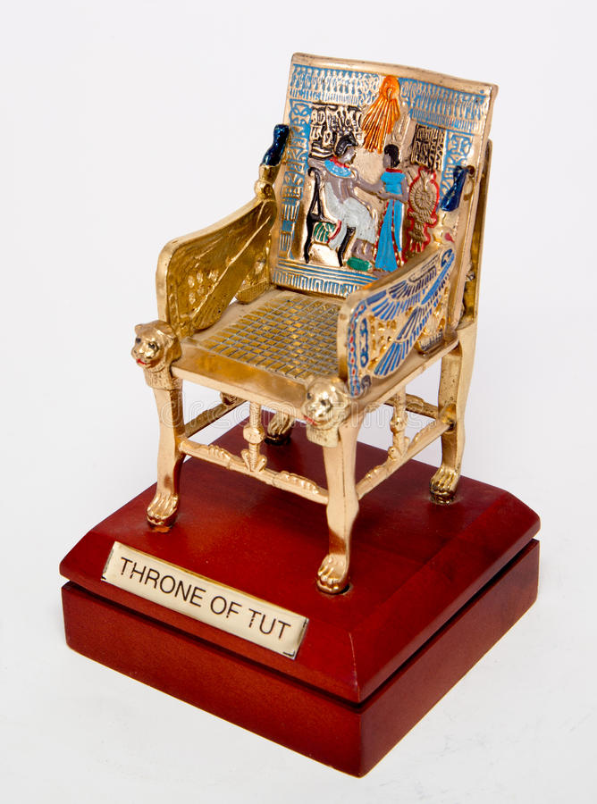 Throne of TUT. Throne of king Tutankhamen on white stock image