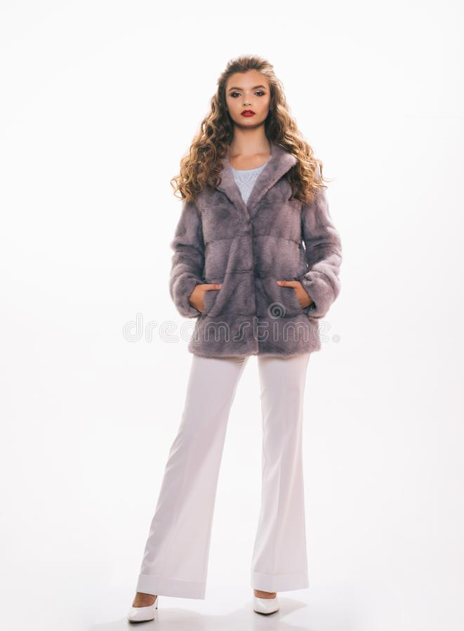 Throw it on for chic elegance. Young woman wear elegant winter coat. Winter fashion trends. Pretty woman in fashionable. Fur coat. Fashion model wear luxurious royalty free stock images