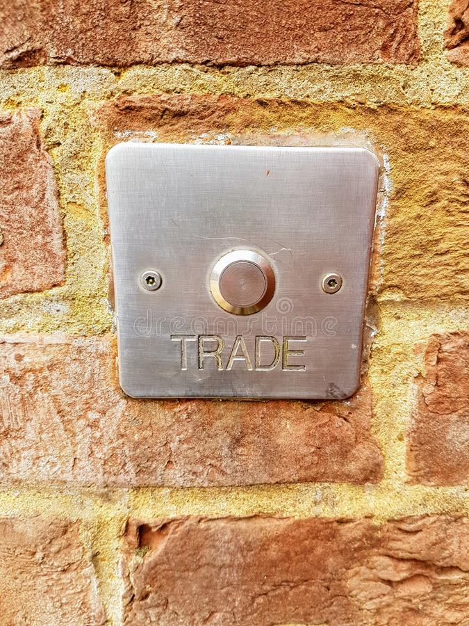 A buzzer dictating tradesmen only entrance. A throwback to the days of the great class divide where tradesmen could not be seen using the main entrance of a royalty free stock image