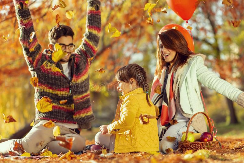 Throwing autumn leaves royalty free stock photography