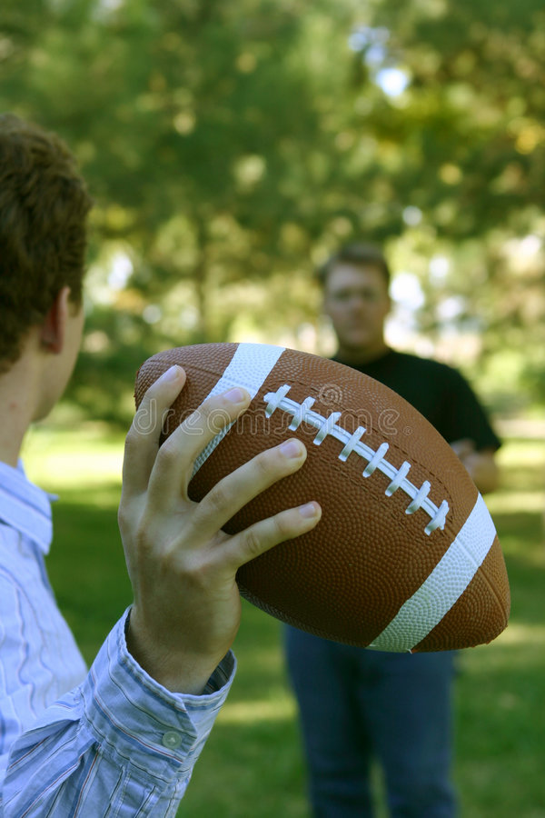 Throwing the football stock photo