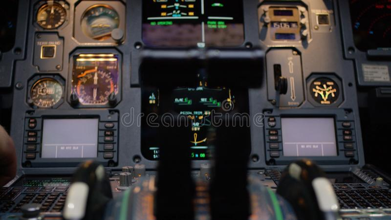 Thrust levers of a twin engined airliner. Thrust levers on the centre pedestal instrument panel. Switches and dials stock images