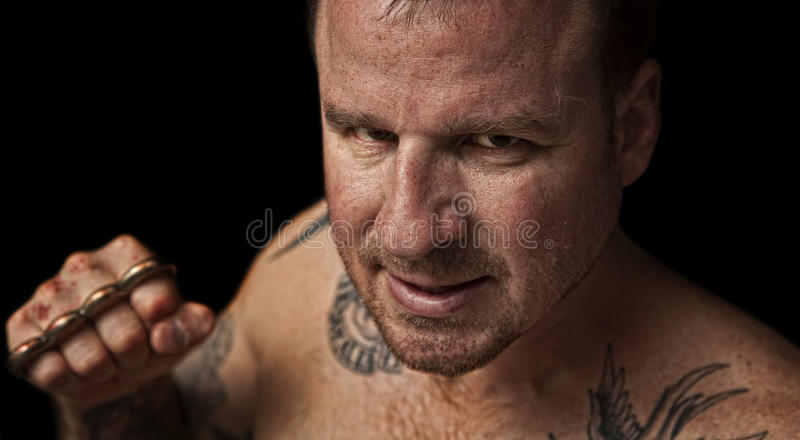Download Thug with Brass Knuckles stock image. Image of beard - 19035025