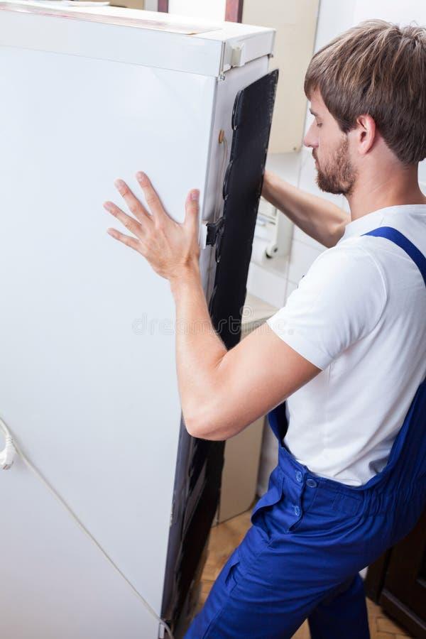 Thuis bevestigend koelkast stock afbeeldingen