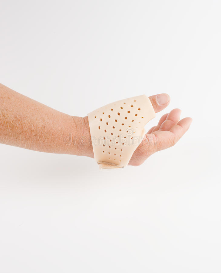 Thumb orthosis, medical support stock images