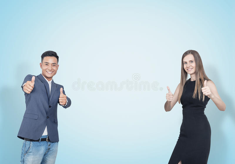 Thumb up business partners, blue stock photography